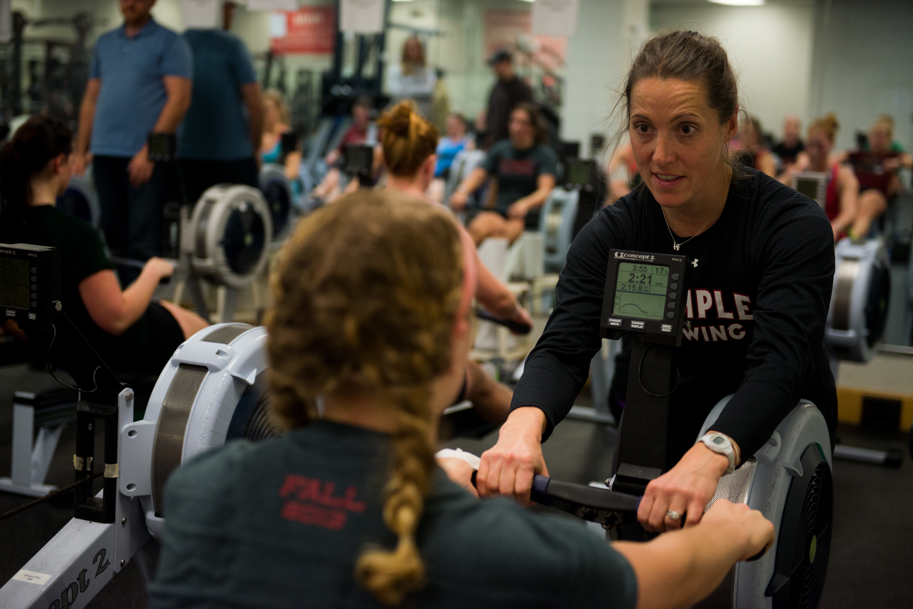 "Second-year women's rowing coach Rebecca Grzybwoski (right) and her team used the motto of ""last one, fast one,"" before the university reinstated the team in February."