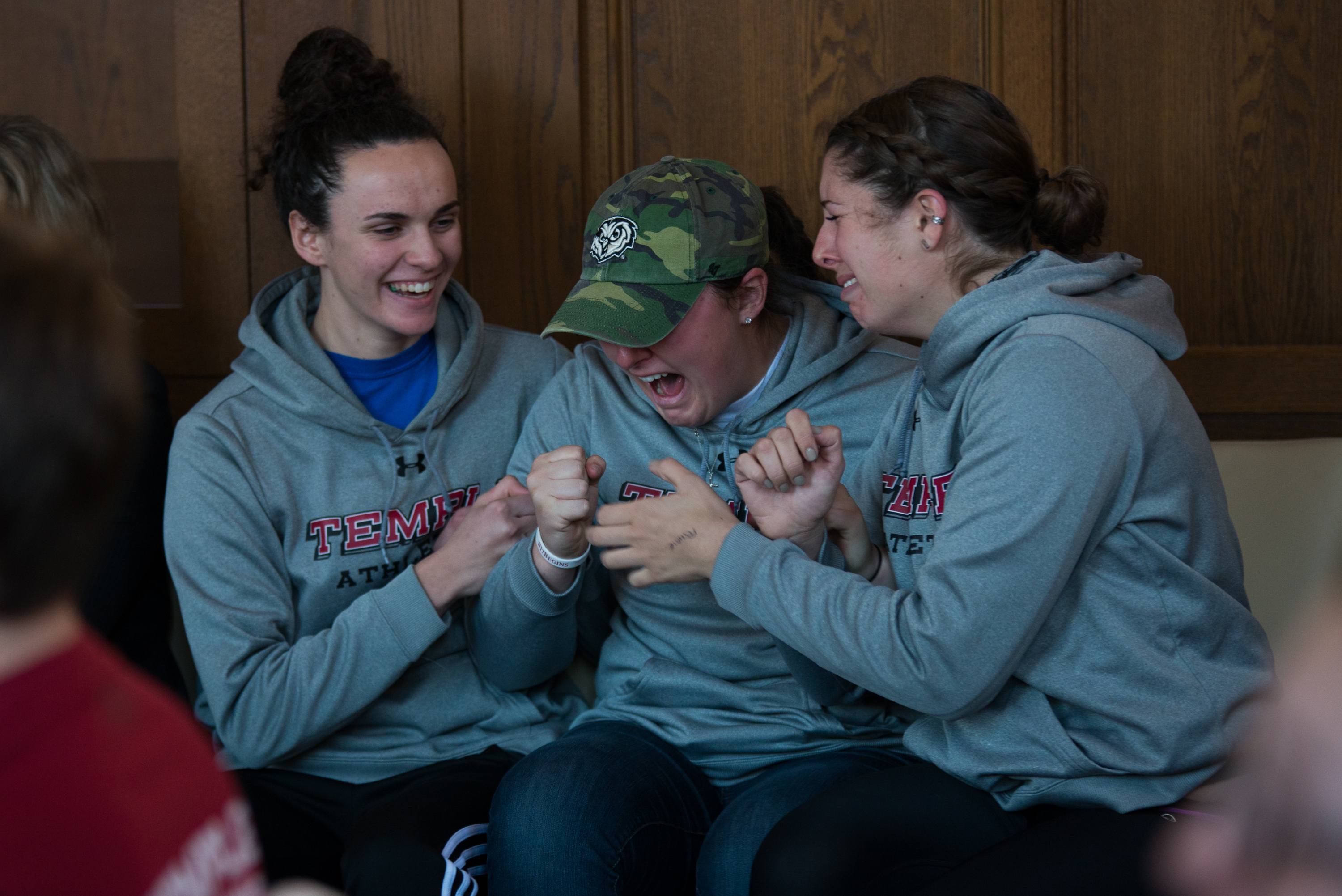 (From left) Rowers Layla Moran, Rachael Braccia and Kelly Hill react in excitement to the news that the men's crew and women's rowing teams will be reinstated. The programs were slated to be eliminated this summer before the Board of Trustees reversed its decision.