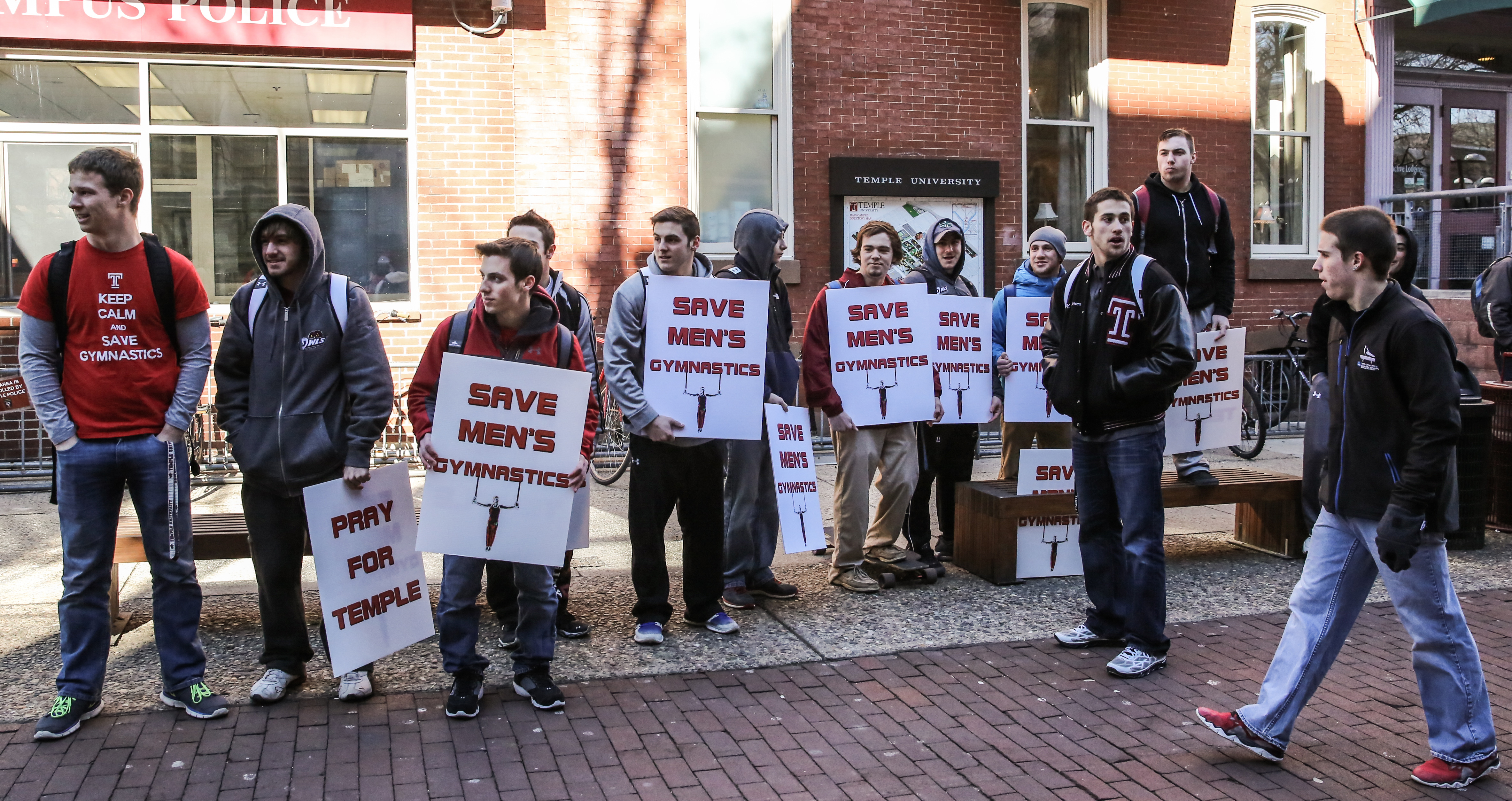 Members of the men's gymnastics team rallied outside Sullivan Hall before a Board of Trustees meeting in February. Coaches and student-athletes from each of the cut sports teams spoke at the meeting.